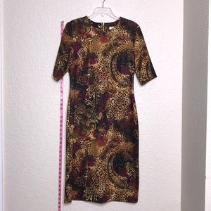 Mid length patterned dress with short sleeves.